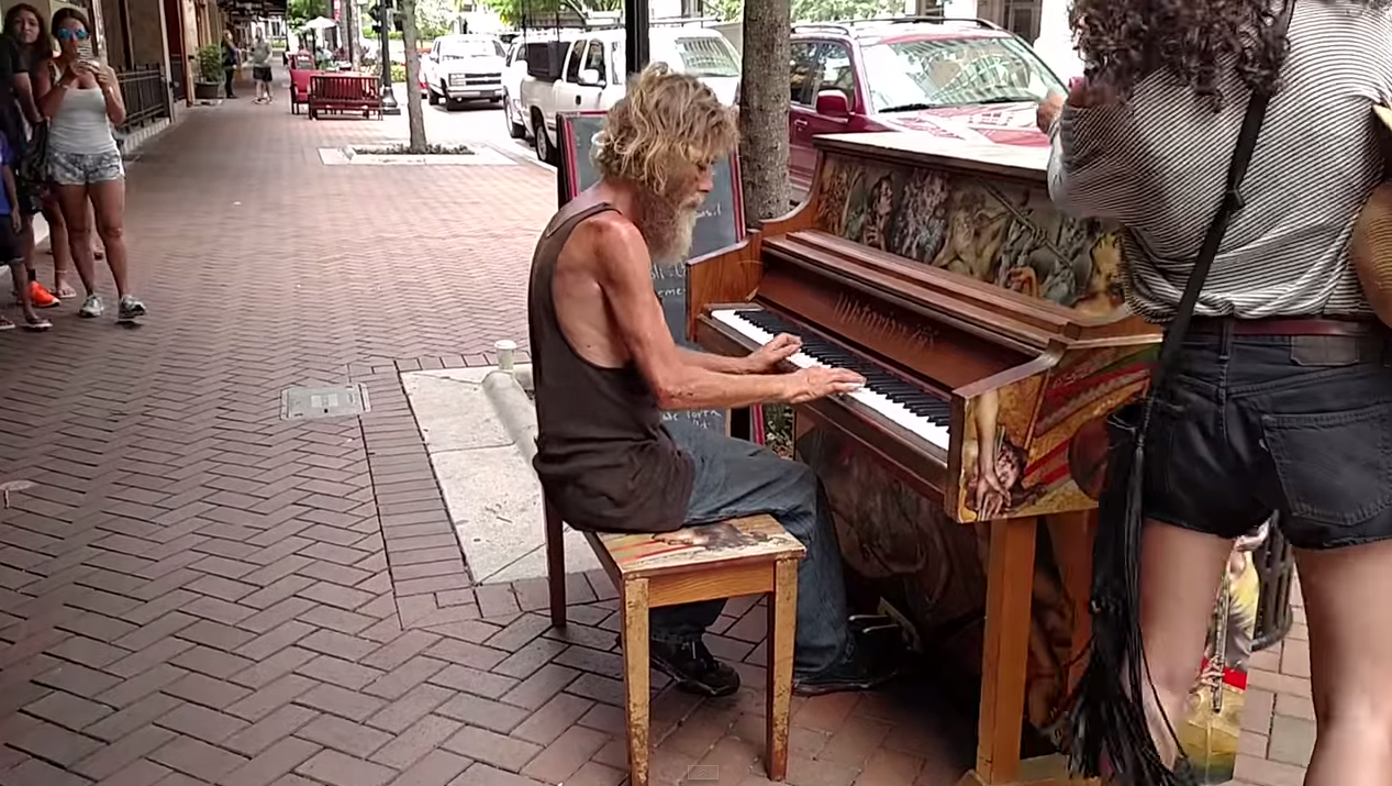 Man Who Is Homeless Plays Outdoors On A Piano
